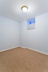 Empty basement bedroom