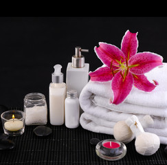 Spa feeling with towel ,candle ,salt in bowl , pebbles, lily