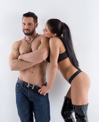 Hot brunette flirts with sexy muscular man