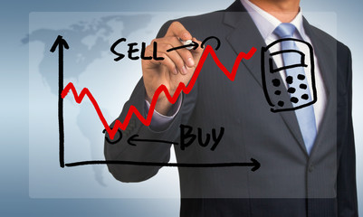 stock exchange graph hand drawing by businessman