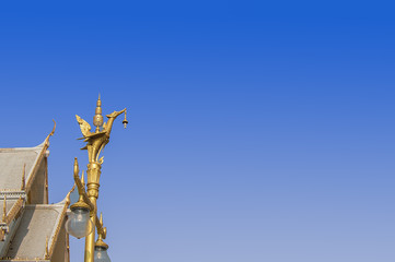 Light pole gold swan and blue sky