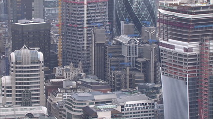 Aerial view above office buildings and skyscrapers in the city of London