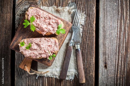 Fototapeta Delicious sandwich made of pate with parsley