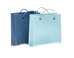 The blue gift package costs on snow, isolated