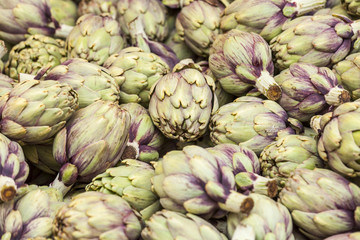 Fresh artichokes on a market counter