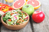 Vegetable salad and ripe fruits