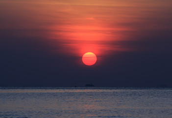 Big red sunset tropical sea background