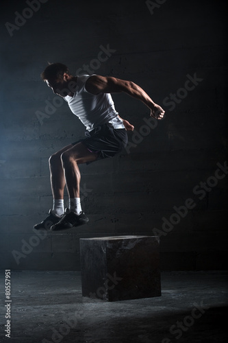 Athlete gave exercise. Jumping on the box. Phase touchdown. - 80557951