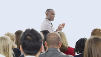 Diverse group of business people attend a business seminar
