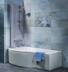 interior bathroom with tub, shower and accessories