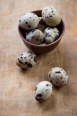 Ceramic bowl with quail eggs, close-up, selective focus