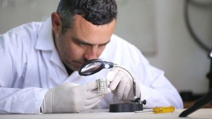 Jeweler In His Studio Working With Diamonds
