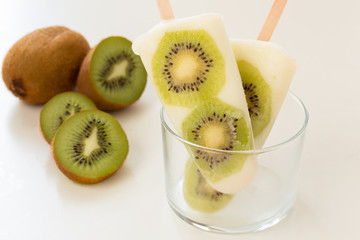 Homemade yogurt ice popsicles with fresh kiwi