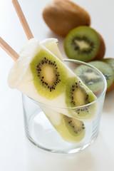 Homemade yogurt ice popsicles with fresh kiwi