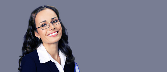 Young businesswoman in glasses, with copyspace