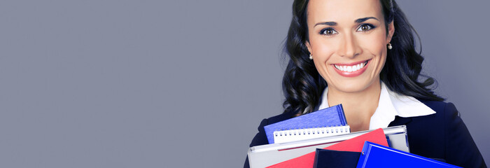 Young businesswoman with folders