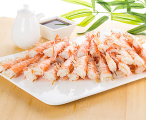 iger shrimps on white plate over wooden background