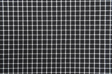 black and white gingham cloth background with fabric texture.