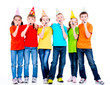 Group of happy children with party blowers.