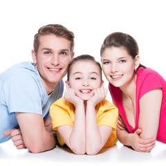 Smiling family with kid sitting in colorful shirt.