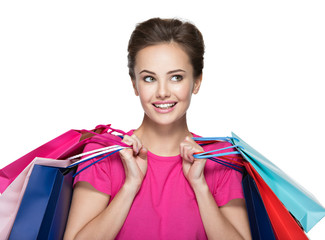 Happy young smiling woman with shopping bags after shopping