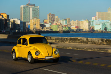 HAVANA - FEBRUARY 26: Classic car and antique buildings on Febru