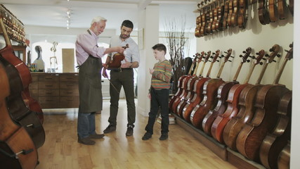 Portrait of shopkeeper in a violin shop