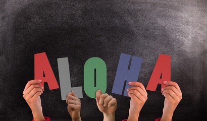 Composite image of hands holding up aloha