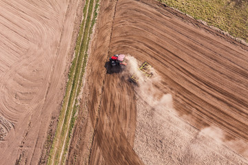 aerial view of  of tractor on harvest field