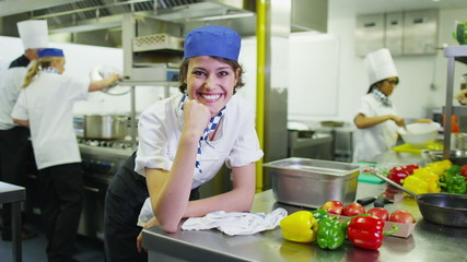 Portrait of a happy young worker in a commercial kitchen