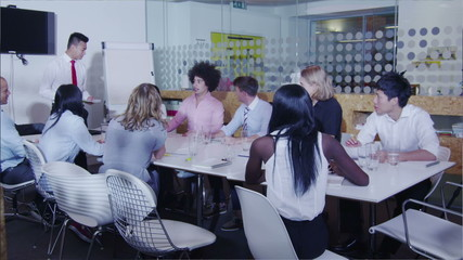 Time lapse of busy mixed ethnicity business team in boardroom meeting