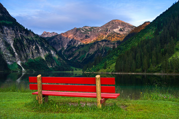 Red Bench on the Lake in Mountains