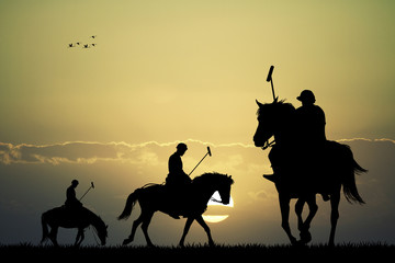 polo players at sunset