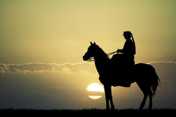 Horsewoman at sunset