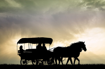 carriage western at sunset