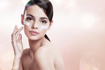 Skin care teenage girl putting face cream