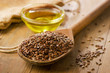 Brown flax seeds on a spoon - 80571106