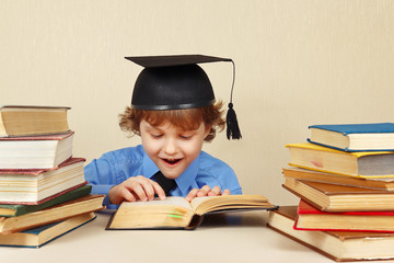 Little professor in academic hat reading an old books