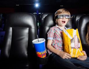 Shocked Boy Watching 3D Movie In Theater