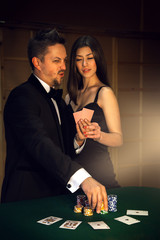 portrait of couple confident of victory in poker