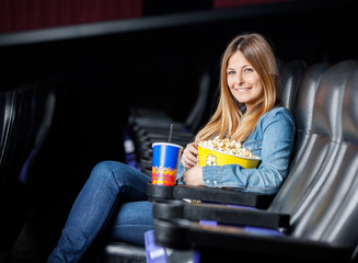 Smiling Woman With Snacks At Cinema Theater
