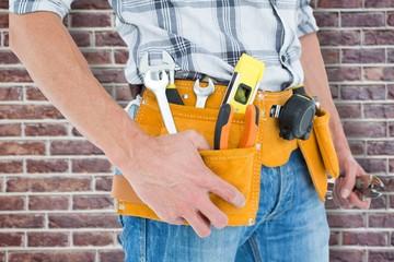 Technician with tool belt around waist