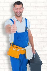 Happy repairman with toolbox gesturing thumbs up