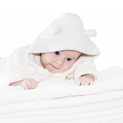 Blue eyes baby boy on white towels