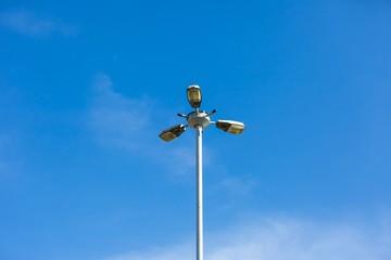 Street lamp on blue sky background