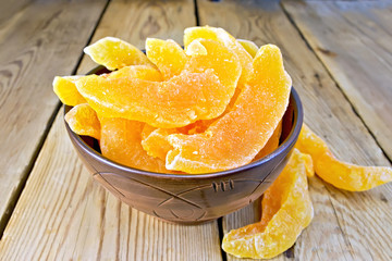 Candied melon in bowl on board