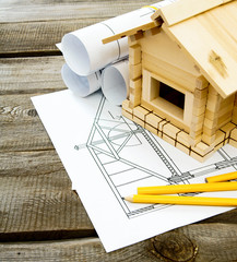 Many drawings for building and small house on old wooden