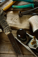 Many old working tools on a wooden background.