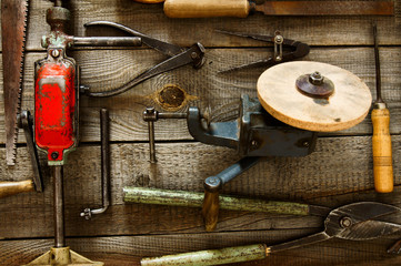 Many old working tools ( plane, saw, pliers and others) on a