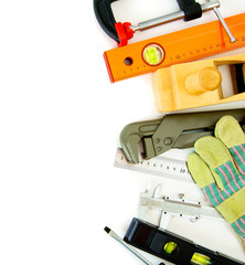 Many working tools - caliper, ruler and others on white